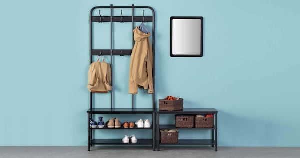 A coat and shoe rack in a blue hallway
