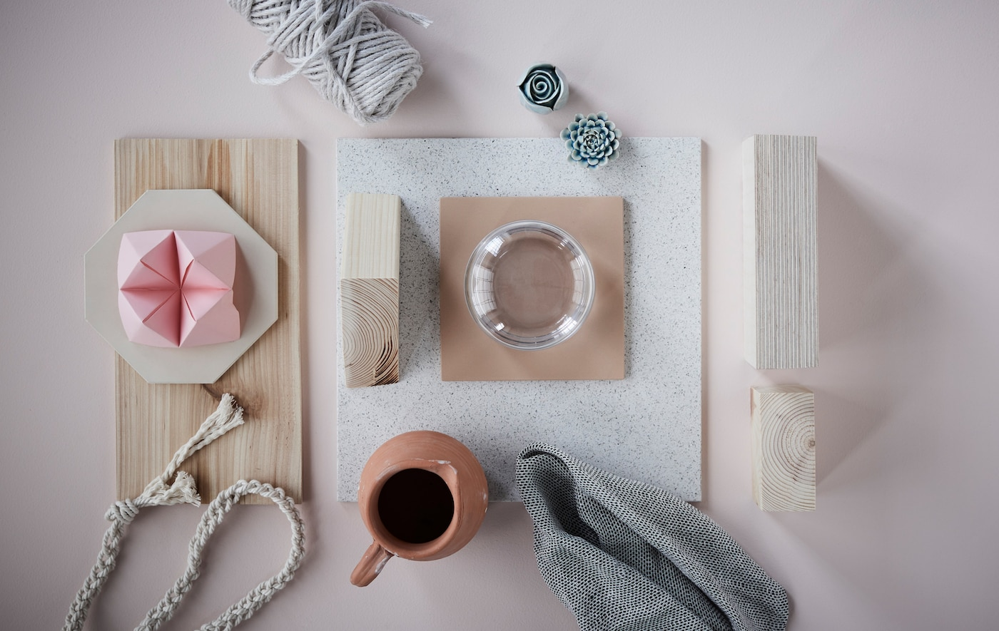 A collage of light wood, textiles and ceramics.