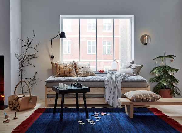 A collection of products from the VARMER series incuding a rug and textiles.