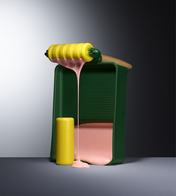 A colourful paint roller set with dripping pink paint.