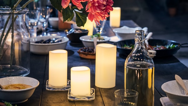 A colourful party table with LED Candles and a floral centre piece set up for Diwali