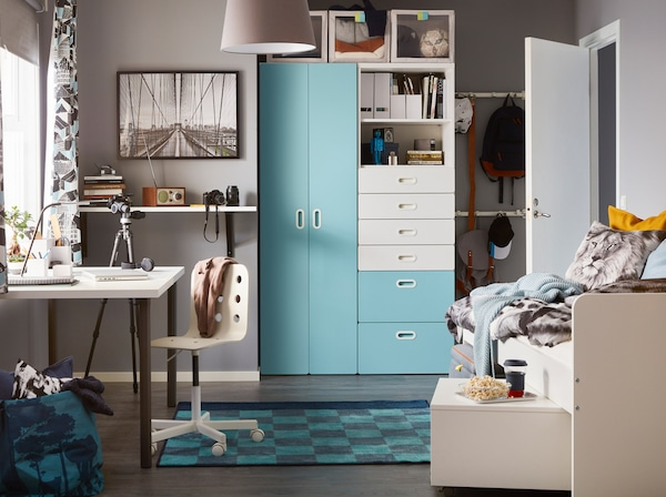 A contemporary turquoise, grey and white children's bedroom with a white and light blue STUVA/FRITIDS wardrobe.