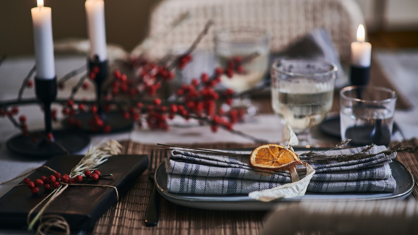 A cosy and festive table decorated with natural fibres and foraged ornaments.