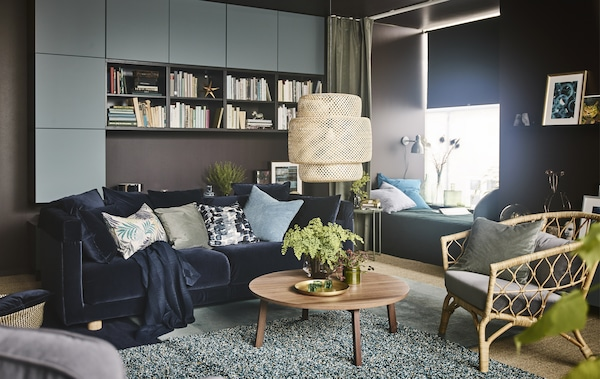 A cosy modern living room featuring brown, blue, and natural materials like rattan and wood.
