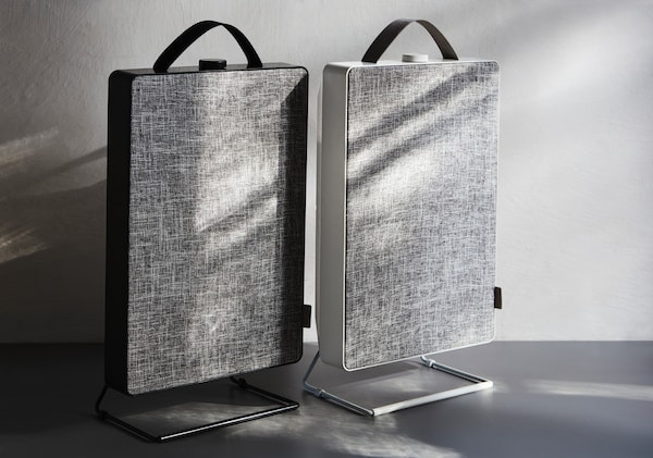 A couple of FÖRNUFTIG air purifiers sitting side by side on a table