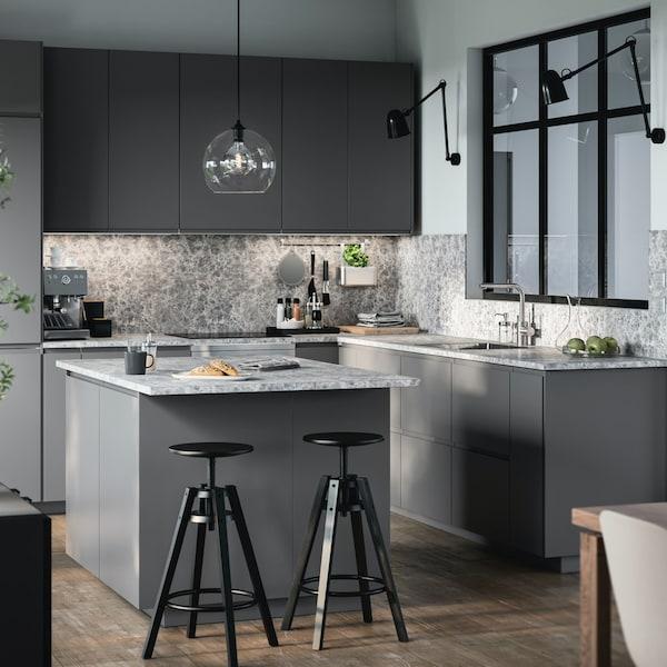 A dark grey VOXTORP kitchen with an island