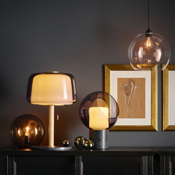 A dark room with glass EVEDAL and FADO lighting.
