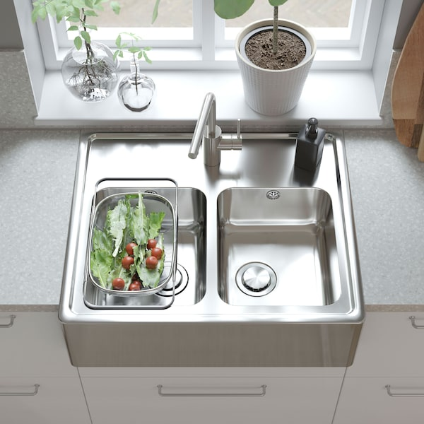 A deep IKEA BREDSJÖN stainless steel kitchen sink bowl, with two sections.