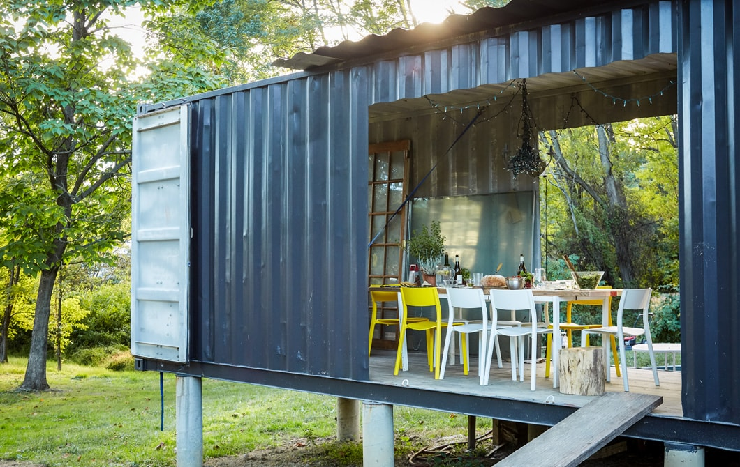 A dining room in a shipping container.