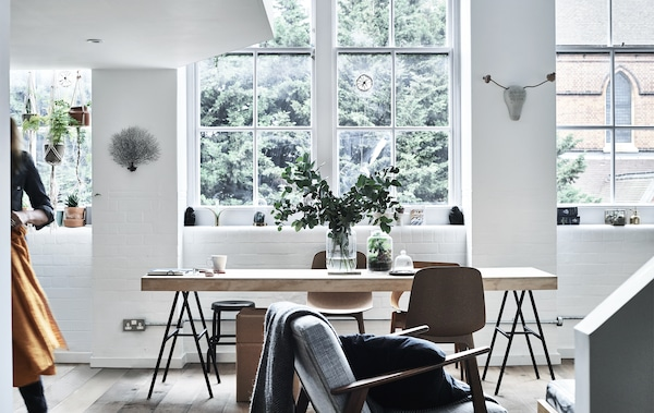 A dining table in front of a large window.