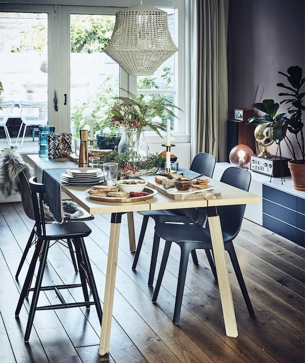 A dining table with a colorful setting for four people.