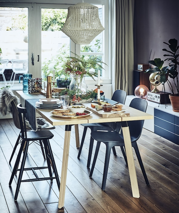 A dining table with a colourful setting for four people.