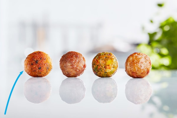 A display of four different IKEA meatballs including beef, chicken, veggie and the new salmon balls to provide more options.