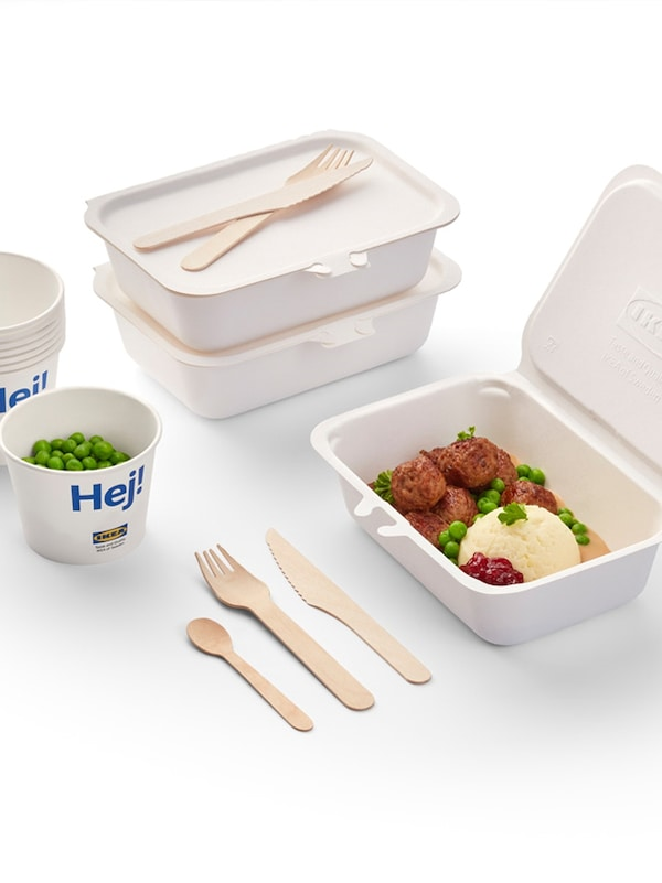 A display of takeout boxes and cutlery on a white background.