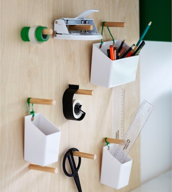A DIY peg board holds organizers and desk supplies.
