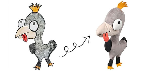 A drawing of a gray bird with an arrow pointing to a soft toy created from the drawing against a white background.