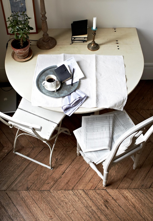 A drop-leaf table makes good use of dead space in the kitchen.