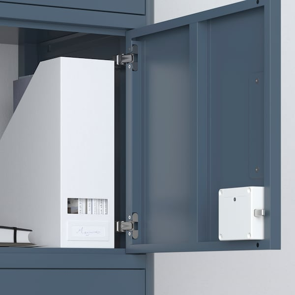 A file holder is inside an open cabinet with a white ROTHULT Smart lock attached.