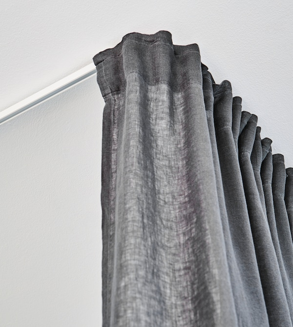 A floor-to-ceiling curtain help keeps your home workout gear separate from the rest of your space.