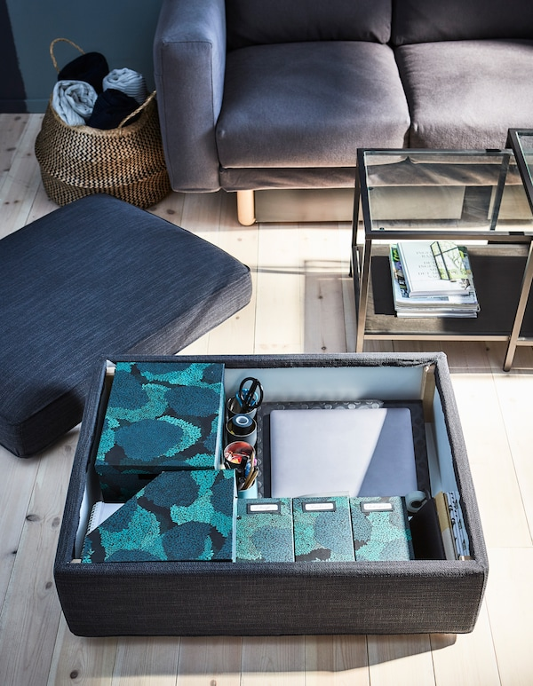 A footstool with storage is the perfect place to keep your off-duty work essentials hidden.