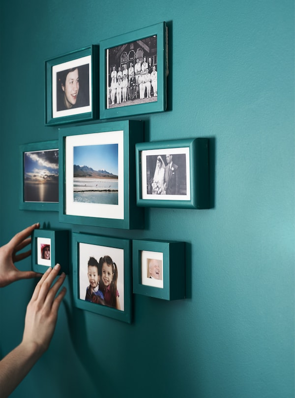 A gallery wall with painted photo frames.