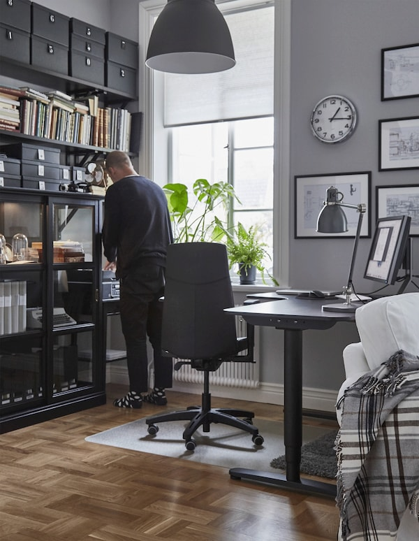 A GIF of a person moving around their home workspace that's designed to be ergonomic.