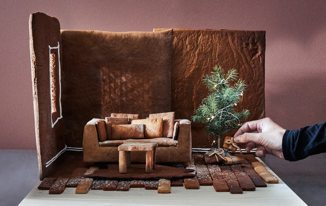 A gingerbread house living room with an IKEA sofa, table and rug