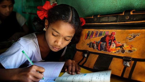 A girl writing in a notebook.