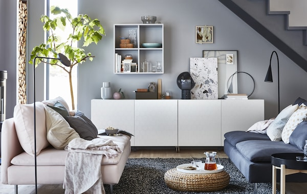 A gray and white living room with low storage unit.