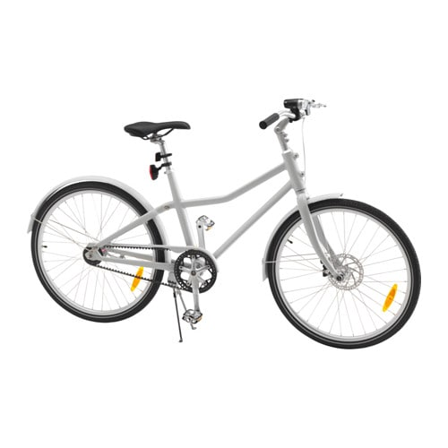 A gray bicycle with a kick stand against a white background.