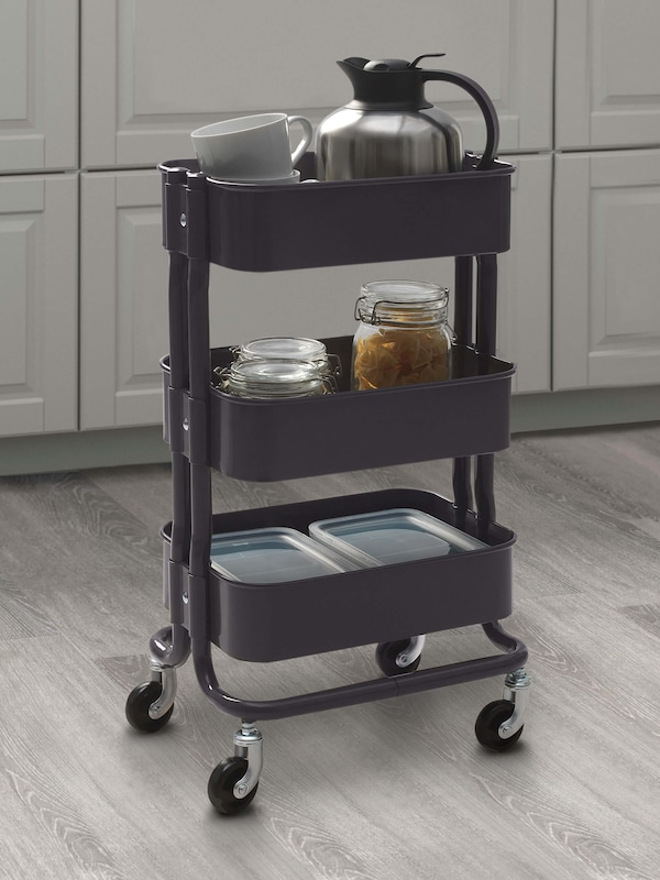 A gray cart with a cofee pot on the top shelf, jars on the second shelf, and storage containers on the bottom shelf.