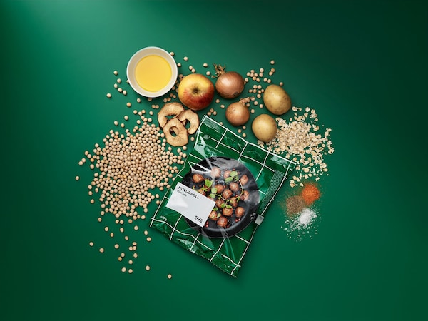 A green bag of IKEA plantballs with an assortment of the products ingredients.