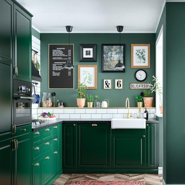 A green BODBYN  kitchen in a corner