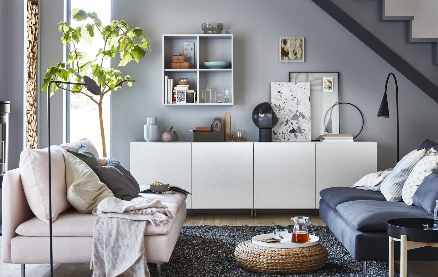 A grey and white living room with low storage unit.