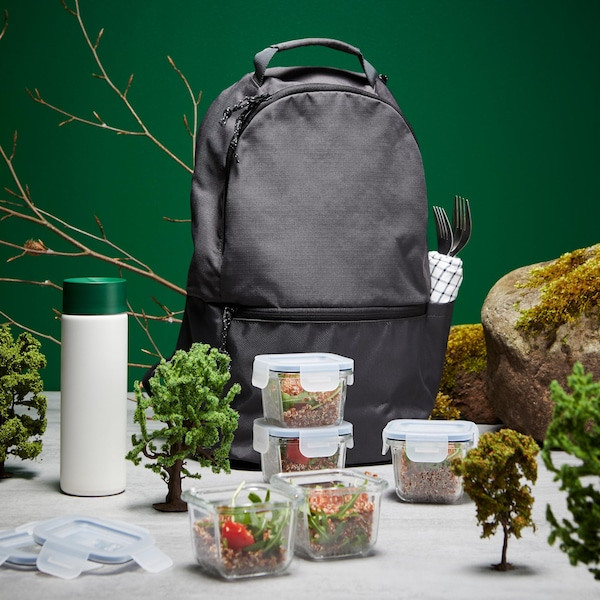 A grey backpack with an assortment of food containers and an insulated flask.