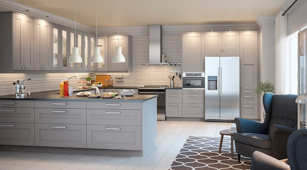 A GRIMSLÖV gray kitchen with dark countertops and stainless-steel appliances.