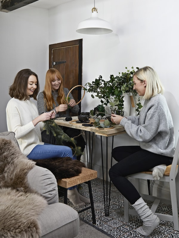 A group of women sitting around a table crafting.