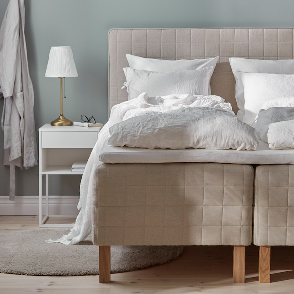 A guide with tips about wooden-base spring mattress beds to help you choose the best bed for you.