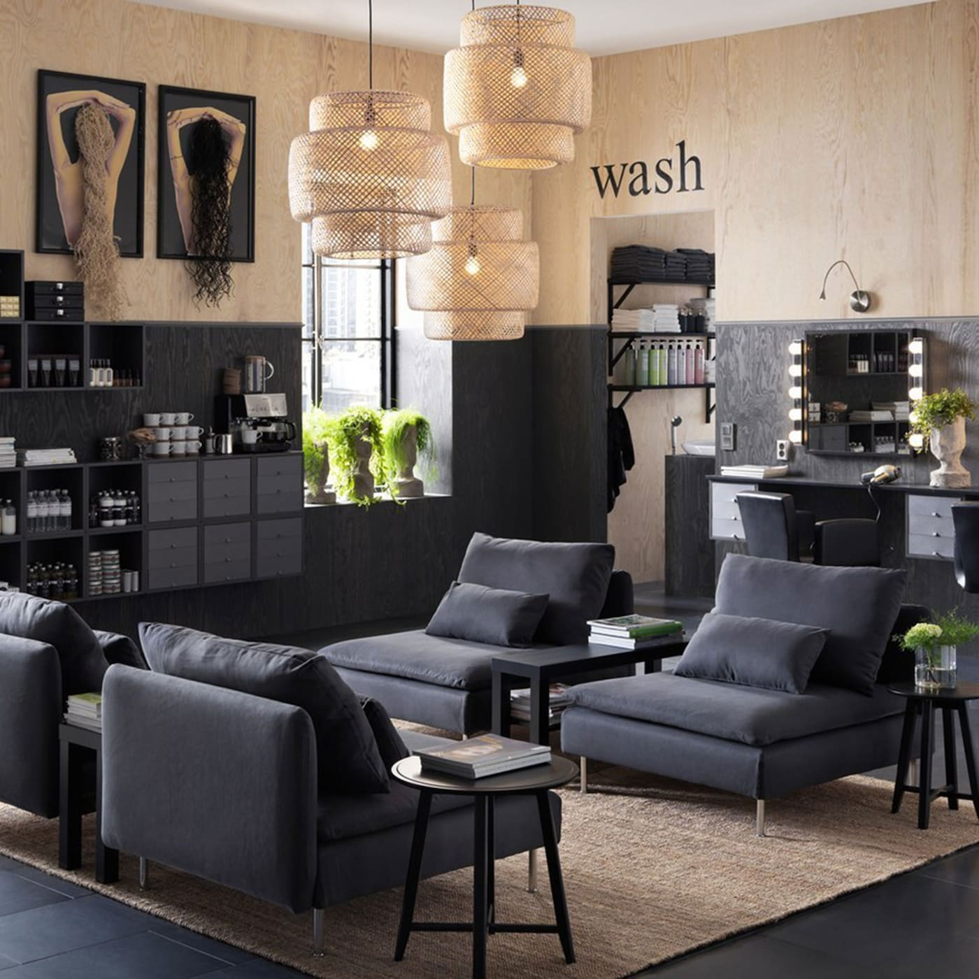 A hair salon furnished with low SÖDERHAMN dark grey armchairs and wall cabinets displaying shampoos.