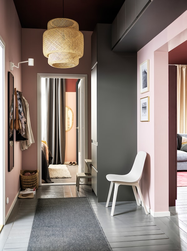 A hallway with a storage combination made from grey METOD cabinets with shelves and four drawers plus wall mounted cabinets.