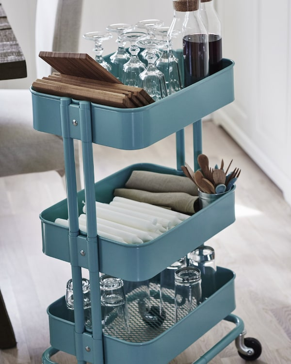 A handy trolley is an easy way to deliver cutlery, glassware and plates to the table.