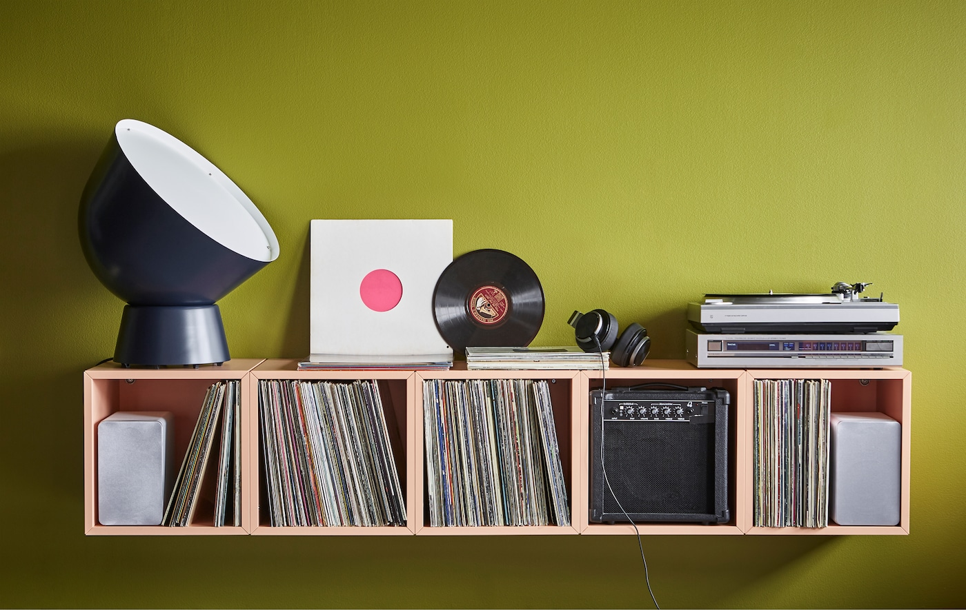 A home DJ-station uses EKET cabinets in light orange for record storage.