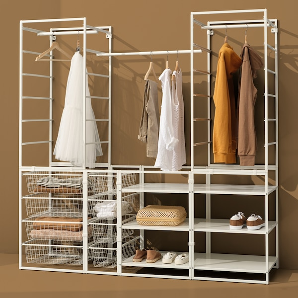 A JONAXEL wardrobe combination with shelves, clothes rails and wire baskets holding clothes and shoes.