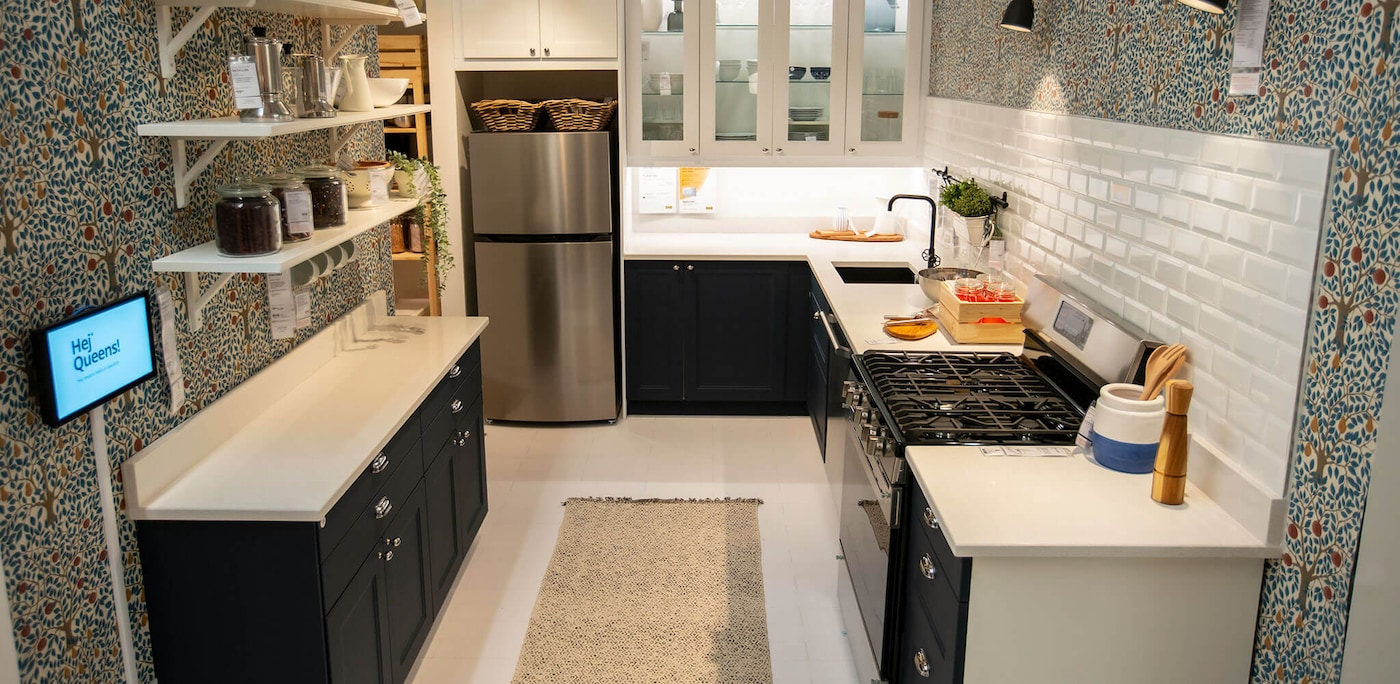 A kitchen display featuring a dark kitchen cabinet front with white countertops and lighting above, linking to News article.