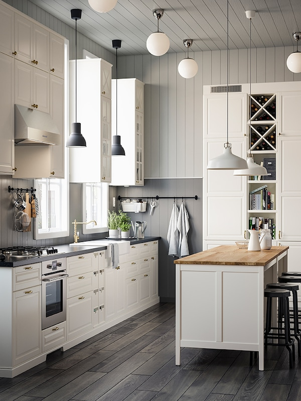A kitchen featuring an island with butcher block countertop