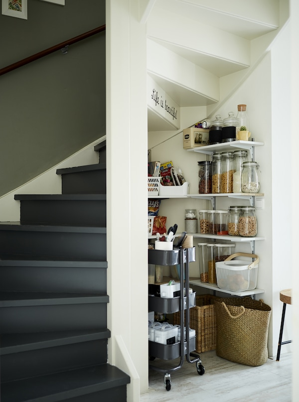 A kitchen pantry under the stairs.