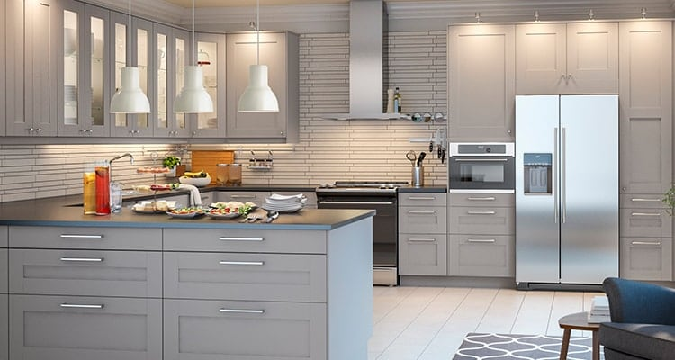 A Kitchen With Light Gray Cupboards And A White Countertop, With A Grey  Accents And