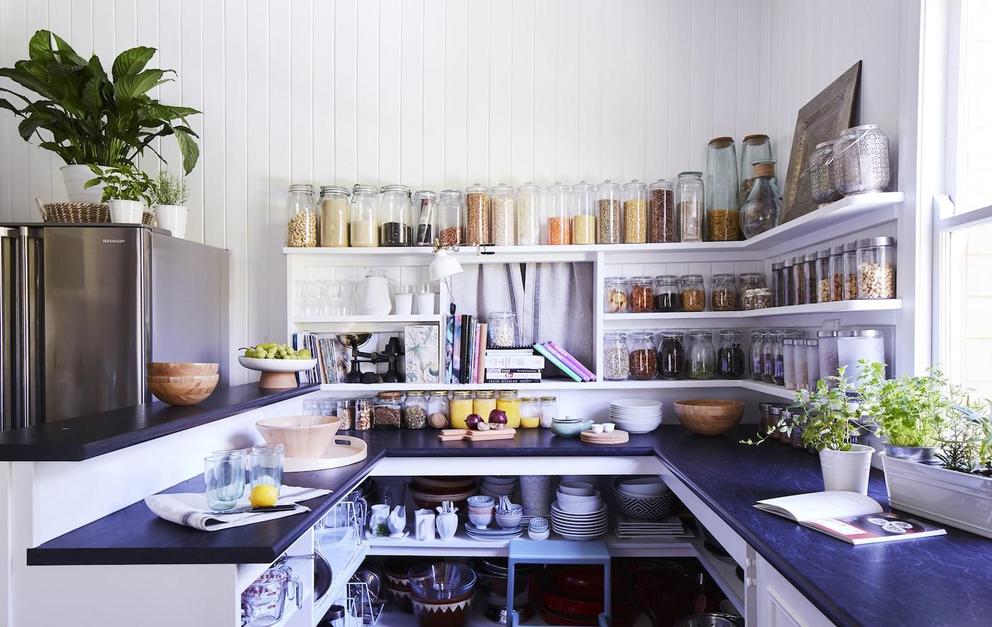 A kitchen with open storage.