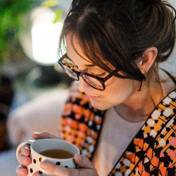 A lady drinking coffee