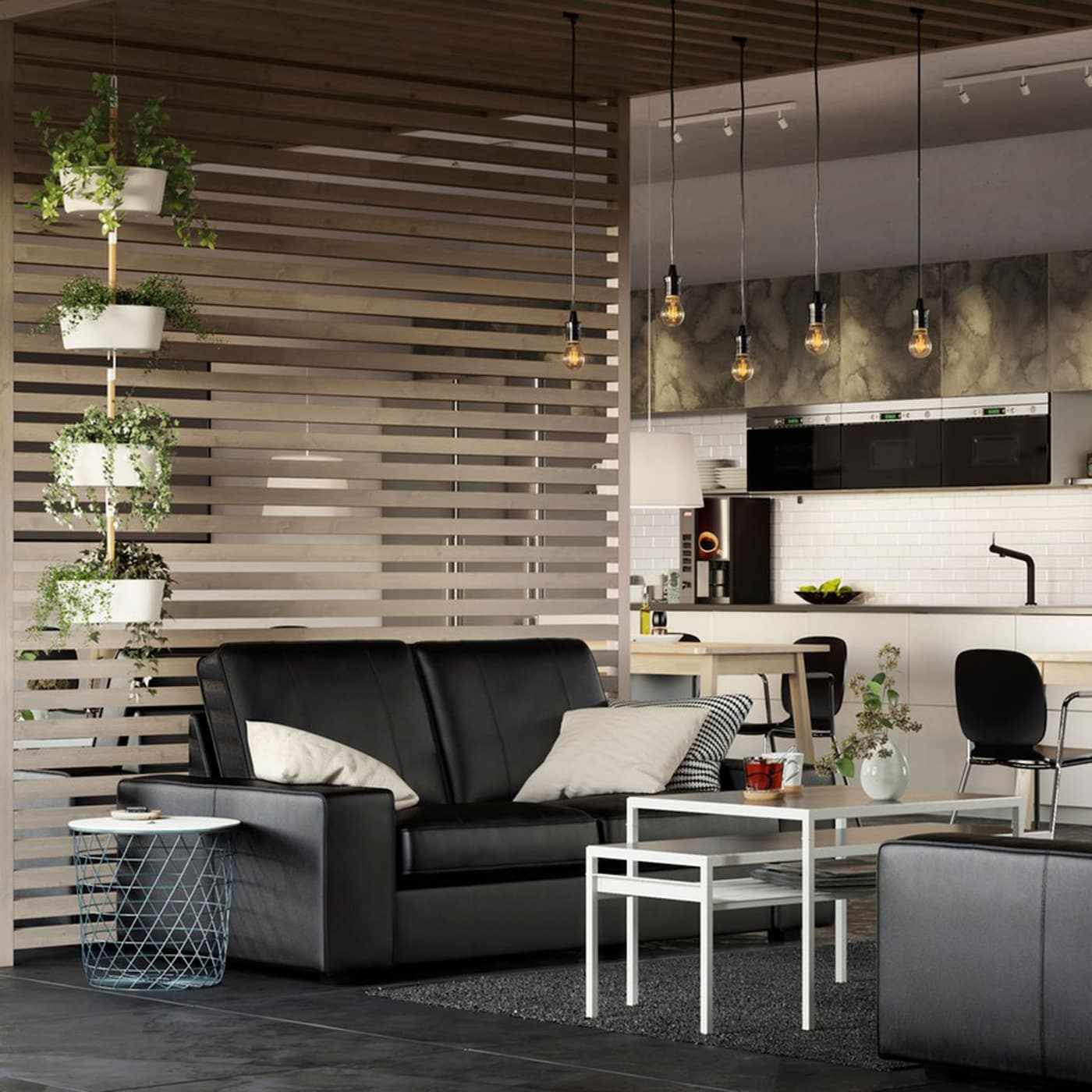 A large airy business office space with IKEA KIVIK black leather sofas and slatted wood room dividers.